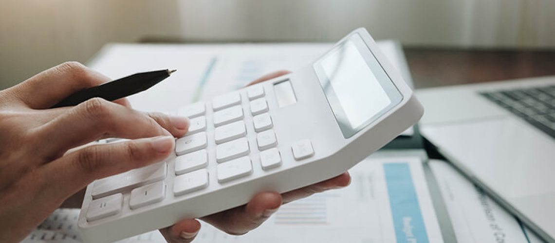 close-up-business-woman-using-calculator-and-laptop-for-do-math-finance-on-wooden-desk-in-office-and-business-working-tax-accounting-statistics-and-analytic-research2- (2)